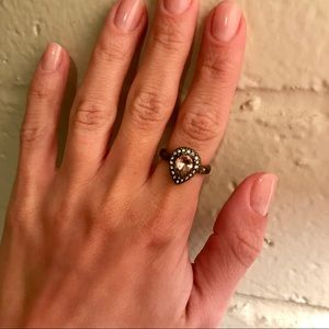 Jewelry - Pear-shaped pink gem ring with CZ halo.
